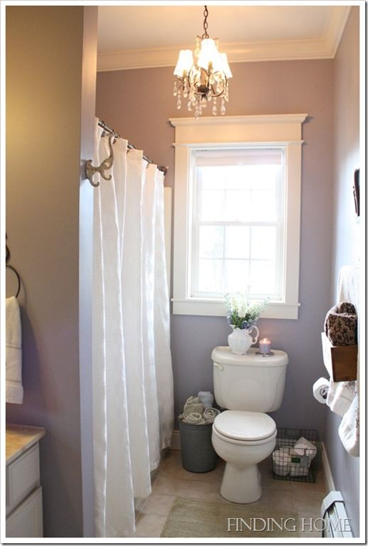 Lovely Guest Bathroom from Finding Home.  I like the paint color against the white.  Very pretty~  Sherwin Williams, Mysterious Mauve, 6262.  Tour the bathroom at:  http://findinghomeonline.com/home-tour-guest-bathroom/