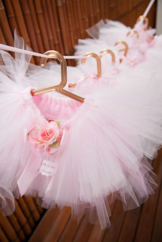 Tutus for party guests...Tip: when hanging on a ribbon like this, either tie knots at intervals or put a dab of hot glue at each spot (let cool) to create a tacky spot for the hanger to grip