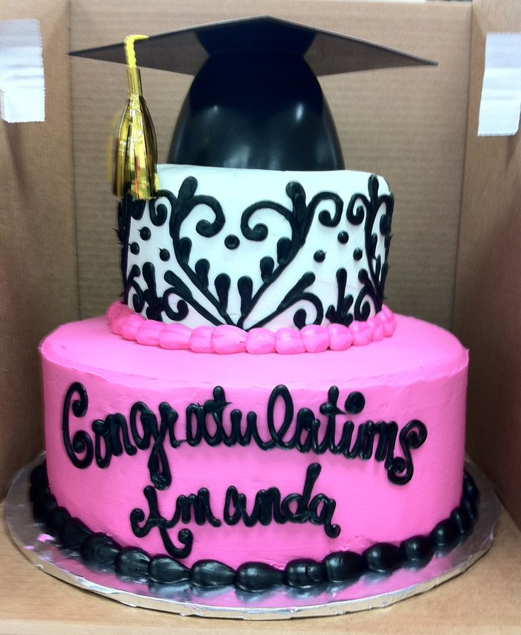 "2 Tier Pink and Black Graduation Cake - Double layers of 6"" and 10"" chocolate cake, All buttercream frosting. Made this cake to match the invitation. Toppper is a plastic Gradutation cap. Annoyed that the photo is blurry though and too late to get a clear one :("