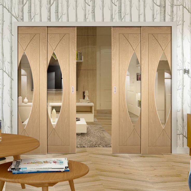 Quad Telescopic Pocket Pesaro Oak Veneer Door - Clear Glass.    #glazeddoors #interiordoors #oakdoors #glazeddoors #interiordoors #telescopicdoors #pocketdoors #hiddendoors #doors #interiordesign