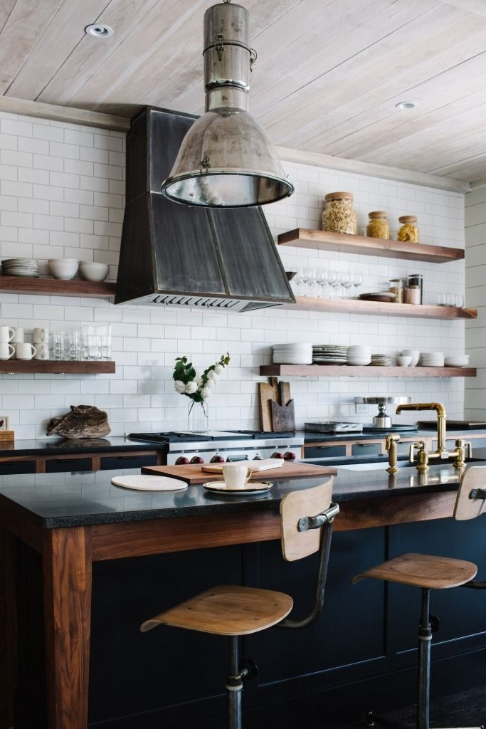 Kitchen countertops are black granite. The ceilings are pine boards washed in Behr's Antique White.