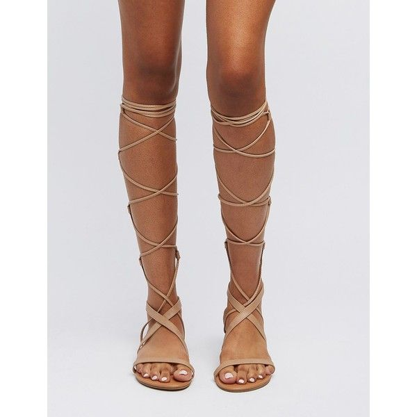 Charlotte Russe Lace-Up Knee-High Gladiator Sandals ($36) ❤ liked on Polyvore featuring shoes, sandals, nude, strap sandals, roman sandals, lace up flat sandals, criss-cross sandals and strappy flat sandals