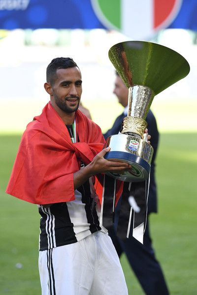 Medhi Benatia of Juventus FC celebrates with the trophy after the beating FC Crotone 3-0 to win the Serie A Championships at the end of the Serie A match between Juventus FC and FC Crotone at Juventus Stadium on May 21, 2017 in Turin, Italy.