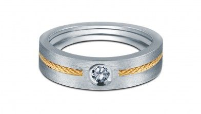Dual Tone men Solitaire Ring - Single stone of Round Brilliant cut Diamond is set with combination of White and Yellow 18Kt Gold. Yellow Gold thread making – gives more attractive look to the ring. These design is one the popular ring design amongst Indian men.