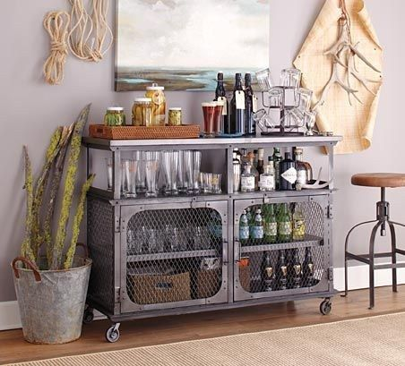 The metal cage doors may seem intimidating, but who wouldn't want to be a little overprotective, right? | 19 Ways An Industrial Bar Cart Can Improve Your Life