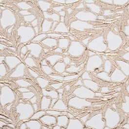 Special collection:  Mood's exclusive acquistion of fine designer lace fabrics from a leading lace atelier. This fine metallic lace features an ornate, scrollwork pattern. Medium weight and perfect for jackets, tops, dresses and more.