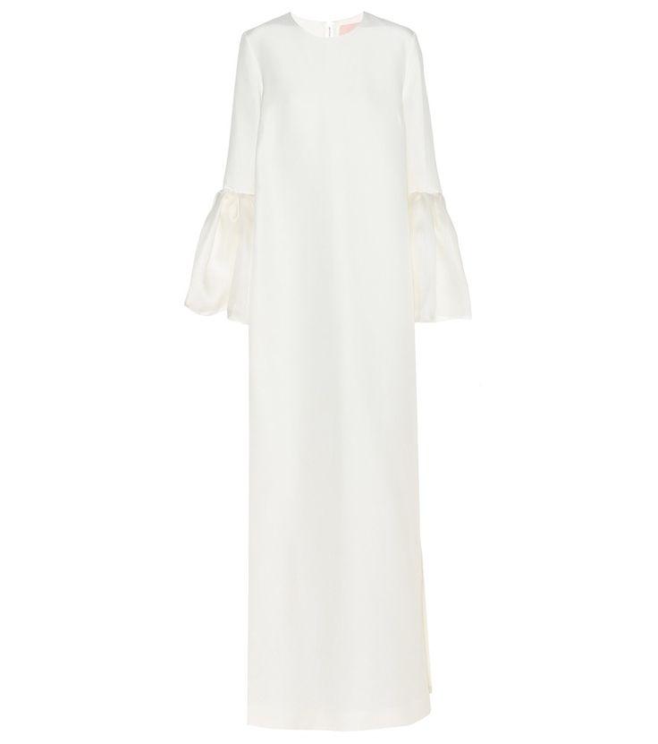 Roksanda - Kleid aus Seide und Baumwolle - Roksanda ist für seine femininen Kreationen berühmt. Dieses cremefarbene Kleid des Labels erzeugt eine lockere Silhouette, die fast bis an den Boden reicht. Die charakteristischen, in Rüschen gelegten Bündchen sorgen für eine extravagante Note. Bewundernde Blicke sind Ihnen in diesem außergewöhnlichen Design garantiert. seen @ www.mytheresa.com