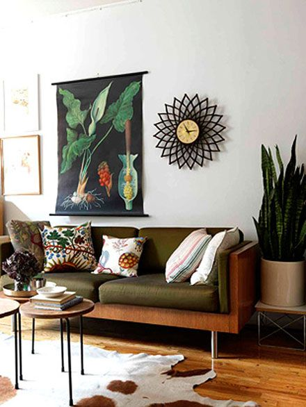 Cozy and eclectic. love the rich colours that still remain pretty neutral and the botanical influence.