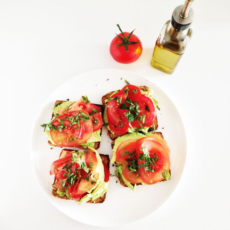 Avocado and Tomato on (sprouted bread) Toast.  Simply #vegan