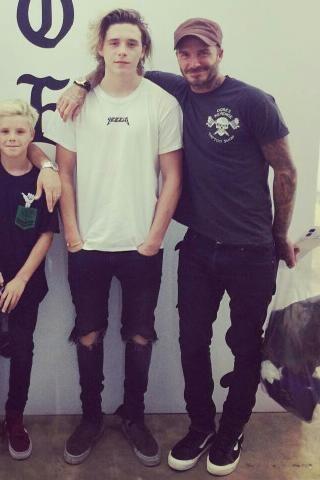 10d299e92ae398 David Beckham wearing Saint Laurent Skinny Fit Raw Hem Denim Jeans and Vans  Old Skool Sneakers in Black