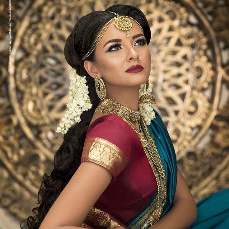 South Indian bride. Gold Indian bridal jewelry.Temple jewelry. Jhumkis. Maroon silk kanchipuram sari purple blouse.Braid with fresh jasmine flowers. Tamil bride. Telugu bride. Kannada bride. Hindu bride. Malayalee bride.Kerala bride.South Indian wedding.
