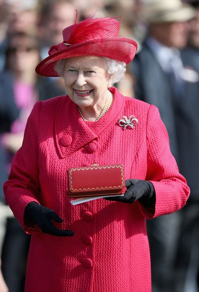 Queen Elizabeth II presents the Queen's Cup at the Cartier Queen's Cup Final at Guards Polo Club on 16 June 2013 in Egham, England