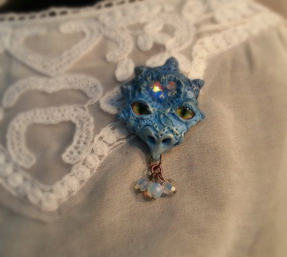 Star Dragon head brooch in blue shades