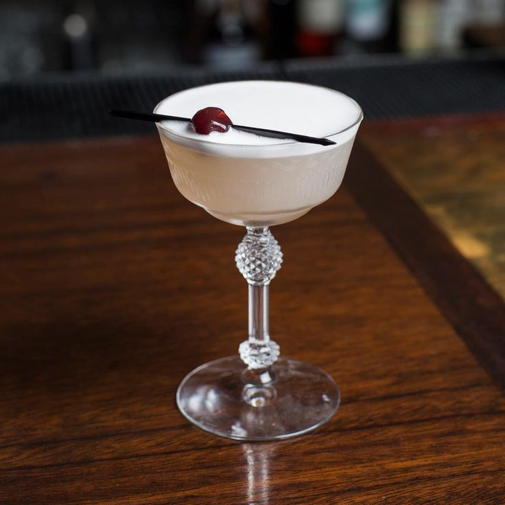 The Lusty Lady 2 OZ GIN 1/2 OZ LIME JUICE 1/2 OZ SIMPLE SYRUP 1/8 OZ CRANBERRY JUICE 1 EGG WHITE 2-3 DASHES SCRAPPY'S LAVENDER BITTERS SHAKE UNTIL FROTHY AND SERVE UP WITH BRANDIED CHERRIES