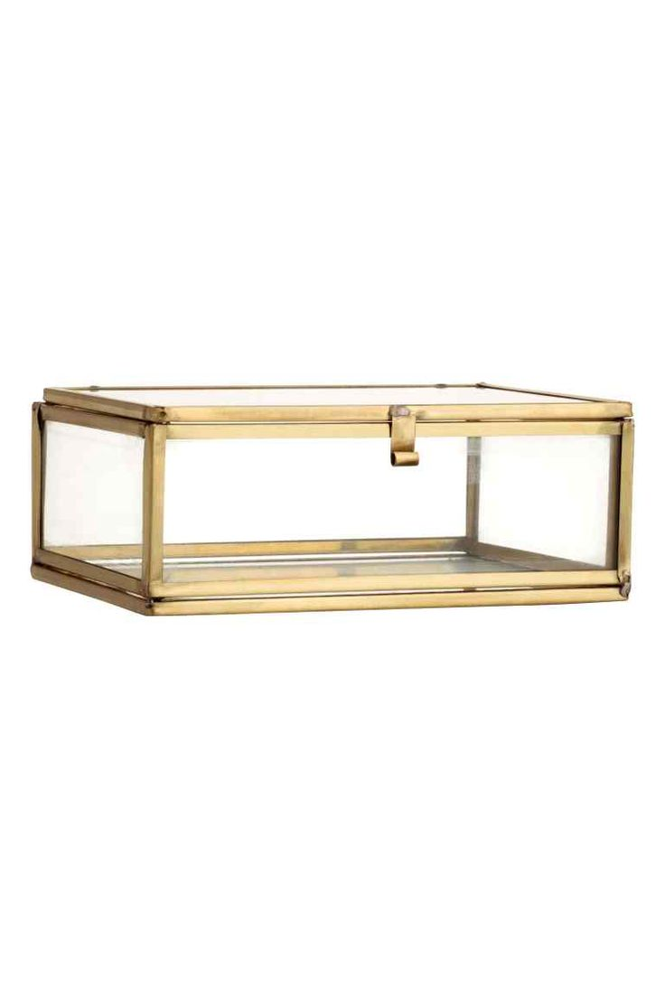 Clear glass box: Rectangular box with a metal frame, clear glass walls and a lid with a small hook fastener. Size 5x10.5x13 cm.