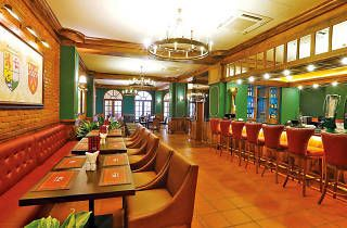 """""""Opened along the lines of a British pub with a Scottish theme, & Co Pub and Kitchen is housed at the onetime headquarters of George Steuart & Co., the oldest corporate house in the country established in 1835"""""""
