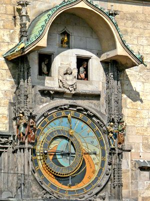 astronomical clock in prague.  The twelve apostles rotate in and out of the windows as the clock strkes...