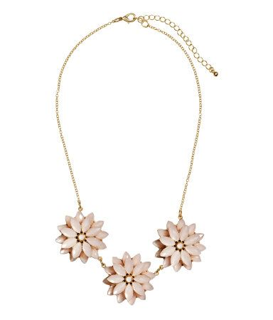 Gold necklace with light pink flower pendants. | H&M Gifts