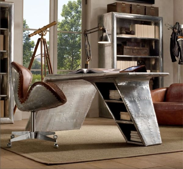 The Aviator Wing Desk is available for purchase online at Restauration Hardware… and was inspired by the bent wing of a plane.