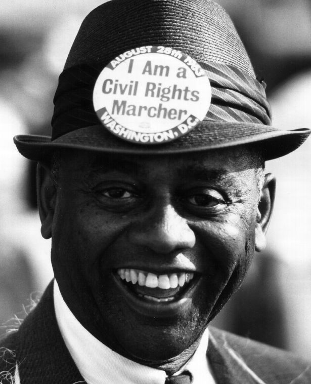 An African American attends the Aug. 1963 civil rights rally in Washington.
