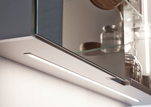 LED underlight strip in the spacious mirror cabinet.