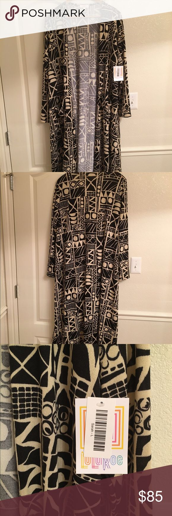 Lularoe Long Sarah Cardigan Sweater NWT Large Lularoe Sarah Cardigan Sweater Duster Long Black and Cream designed. New with Tags. Size Large. See Pics for details. No Trades. LuLaRoe Sweaters Cardigans