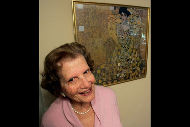 April 14 2005 Maria Altmann stands next to a print of a to recovered Gustav Klimt paintings stolen from her family by the Nazis.