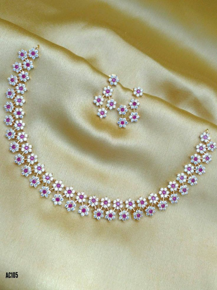 Lovely necklace with cute flower design. Necklace studded with white and pink color CZs. 13 August 2017