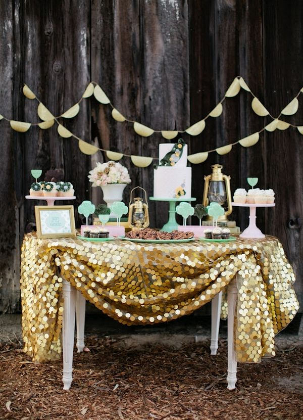 Dessert buffet... Hmmm I like the idea but rather do a kind of purple or green table cloth with the wedding cake in the center and candles around and cookies adds stuffs than use a picture of us :) doesn't sound bad and behind have lights instead... Hmmmm :)