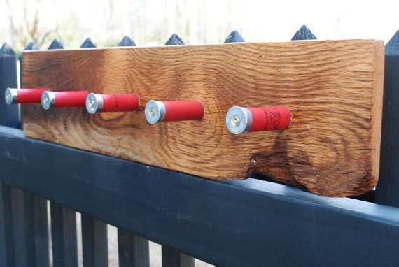 This is a wall-mounted coat or hat rack, made from a solid piece of reclaimed oak barn wood. The finish is several coats of satin lacquer.