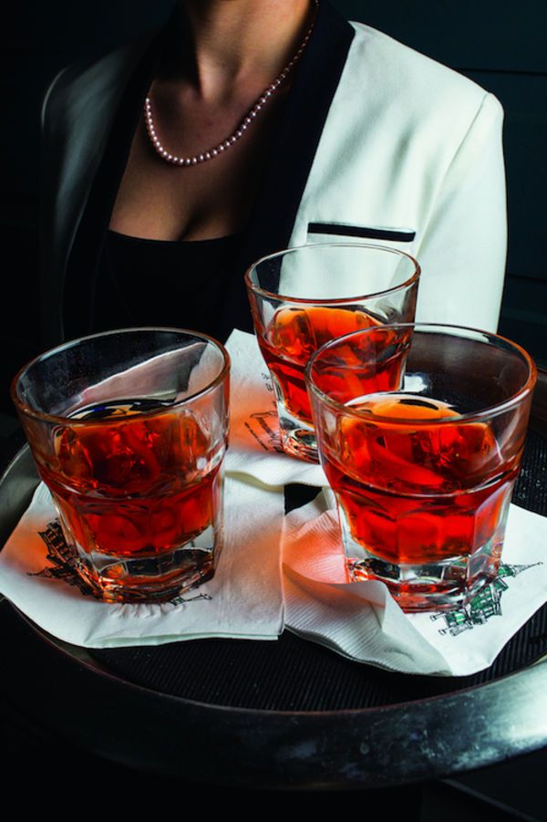 Commander's Palace Sazerac 1⁄2 oz. absinthe (preferably Lucid although I read about using Herbsaint here too) 2 oz. rye or bourbon 1⁄4 oz. simple syrup Peychaud's bitters Angostura bitters Lemon twist