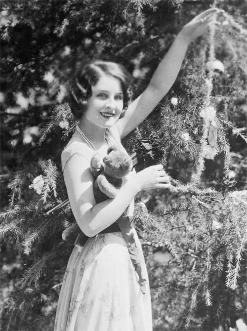 Norma Shearer decorating her Christmas tree, c. 1920s