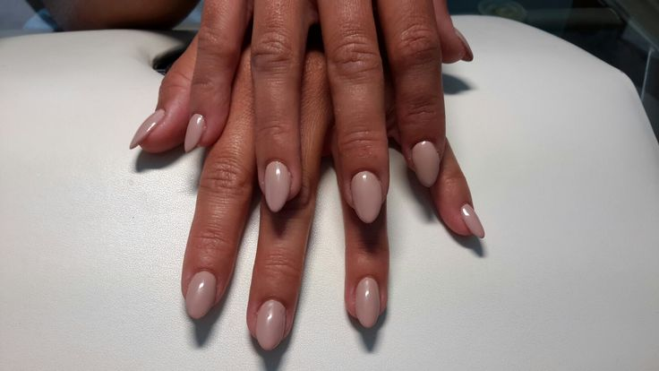 Nude, almondshaped, acrylic manicure with nailform extensions.