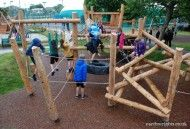 The play tower with traversing ropes and log tangle