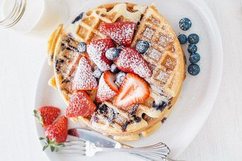 Yummy waffles with berries