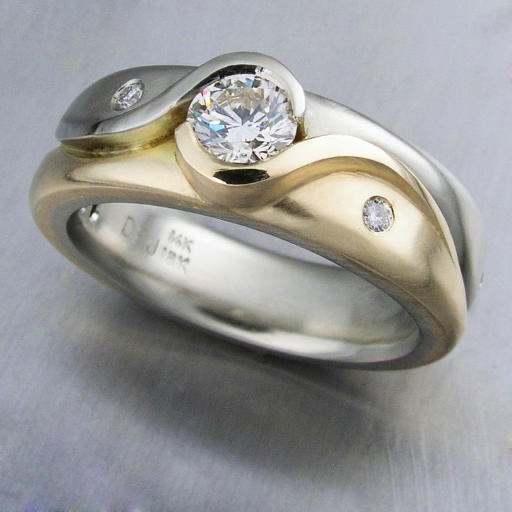 Custom designed wedding ring in 14k white and 14k yellow gold. DFJD