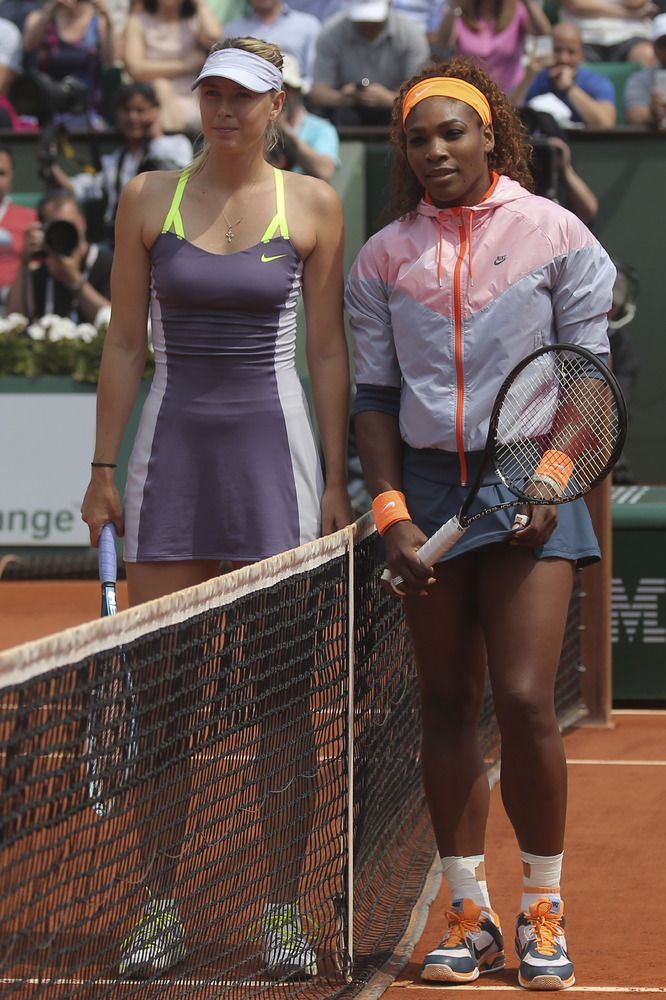 Serena Williams and Russia's Maria Sharapova pose for photographers prior to the start of the women's final of the French Open tennis tournament