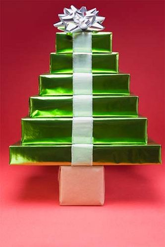 Christmas Gift Tree. Cute way to wrap multiple gifts. Would also make a cute piece of Christmas decor.  I use this idea for bridal shower:large box holds a blanket, the middle box sheets, and the top box the pillow cases.  White or pastel wrapping paper.  I trim the layers with white paper doilies, and top with the honeycomb wedding bells.  Looks like a wedding cake.