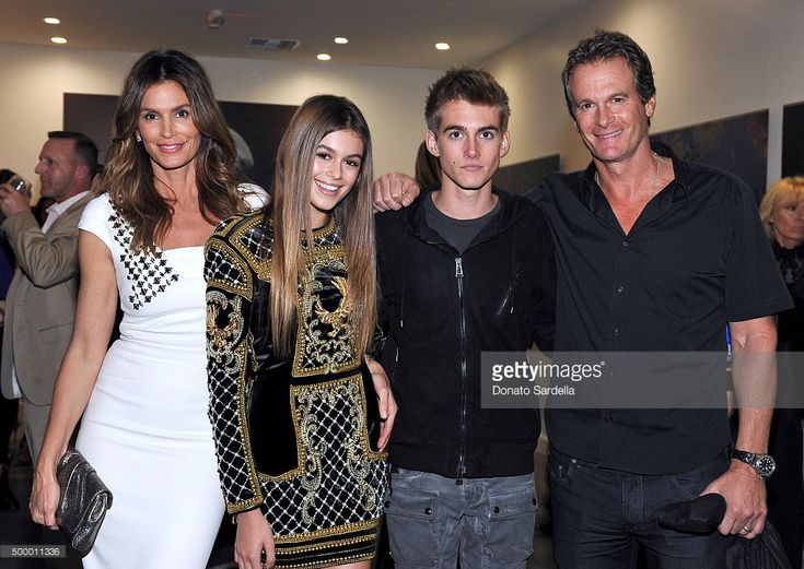 Cindy Crawford, model Kaia Jordan Gerber, Presley Walker Gerber, and businessman Rande Gerber attend a book party in honor of 'Becoming' by Cindy Crawford, hosted by Bill Guthy And Greg Renker, at Eric Buterbaugh Floral on December 4, 2015 in West Hollywood, California.