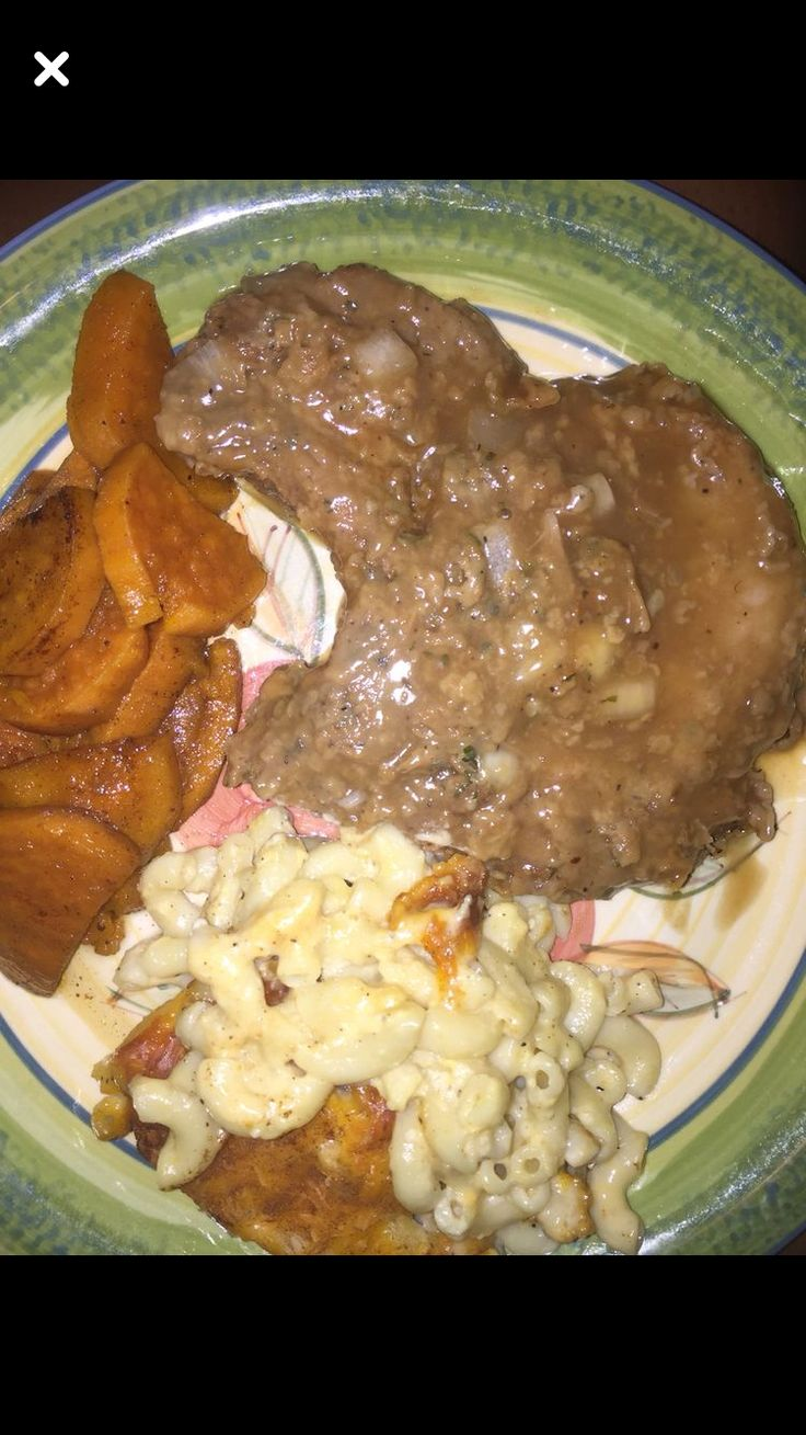 Fried smothered porkchop with oven baked macaroni and cheese and homemade candied yams ummm ummm good!