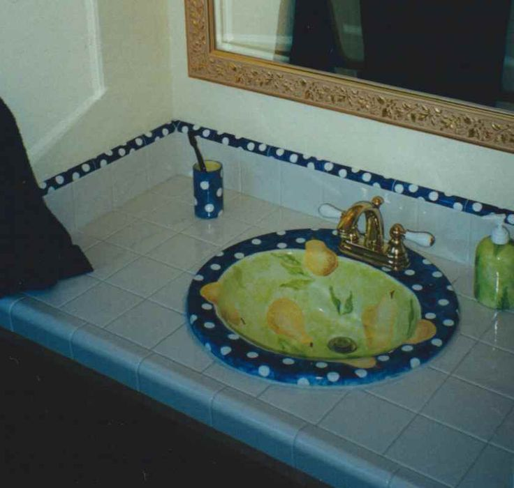 Hand painted pear sink with matching tile border and ensemble. We can do something custom for you! http://greta63.wix.com/notallwhite