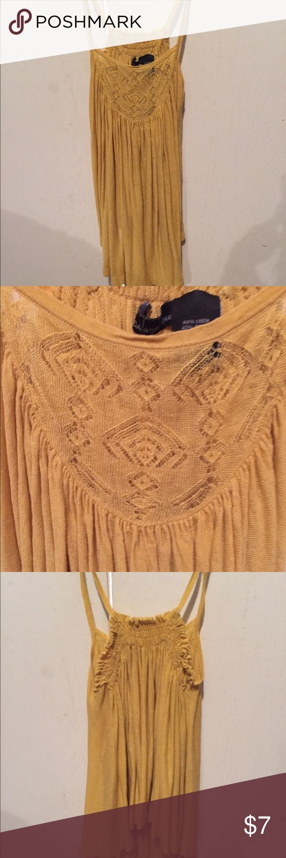 Gold strappy top Cute gold strappy shirt. It's has a pretty lace design in the front up top. Looks really good on Tops Blouses