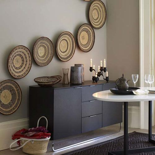 i love the baskets for the african decor idea i have design trend baskets as wall decor by jeanine hays on image via living etc - African Decor