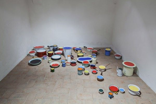 Zhanna Kadyrova, Filling In, 2012, various kitchen and household enameled vessels, tiles, dimensions variable. Galleria Continua San Gimignano, 2013. Photo by Ela Bialkowska