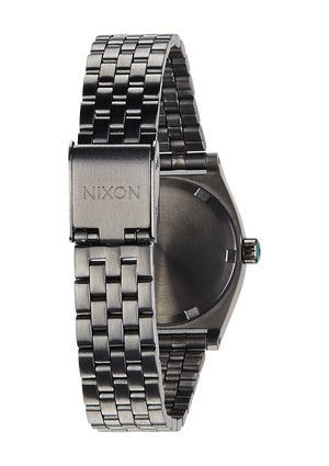 NIXON SMALL TIME TELLER The unexpected always adds a little drama and The Small Time Teller is causing an a scene. The slim, feminine design is draped in unique metal tones and complimentary colors that make for a standout statement. www.jessimara.com