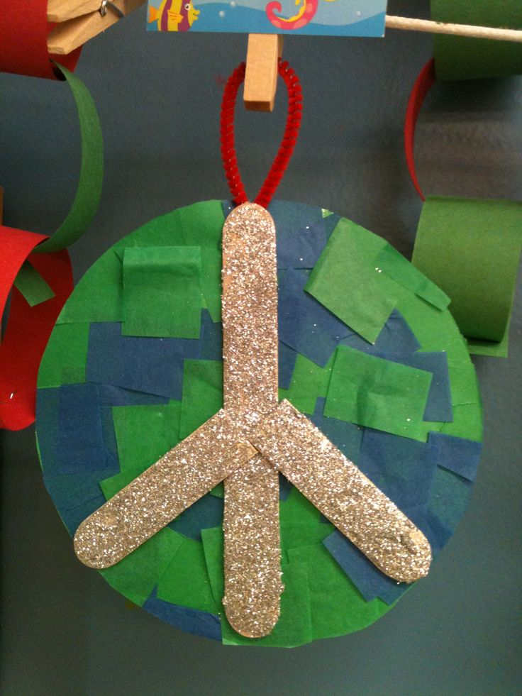"""Preschool Peace Ornament - Contact paper, tissue paper squares, craft sticks and a LOT of glitter. The back said """"Let there be peace on Earth and let it begin with me"""" with their name and the year."""