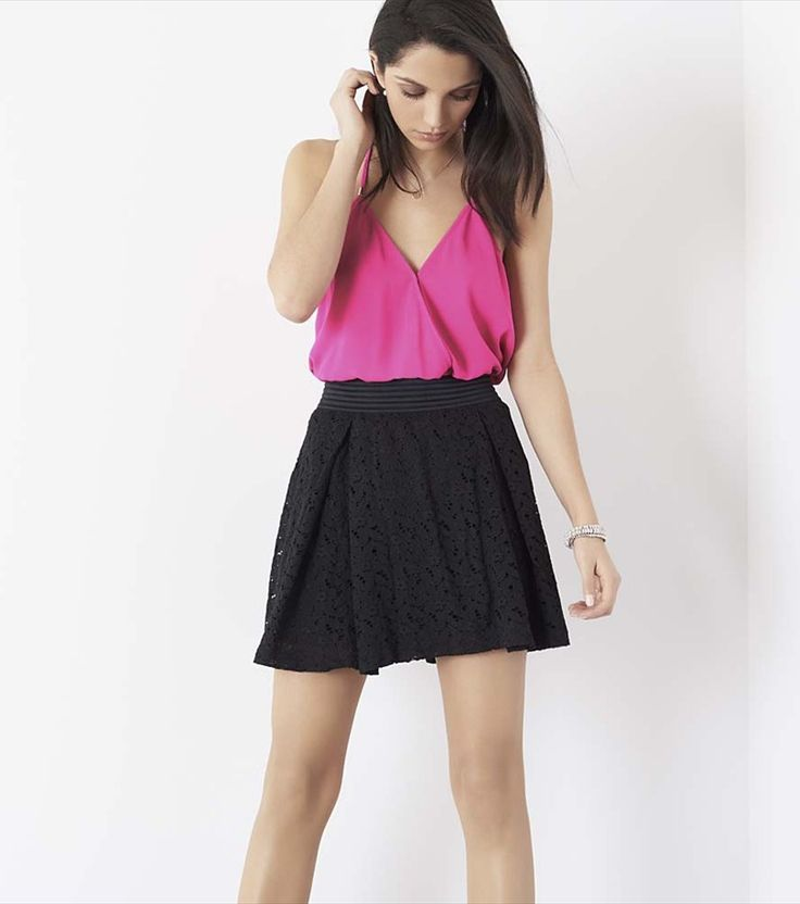 Small talk. Show off that flirty side with this stunning lace skirt.
