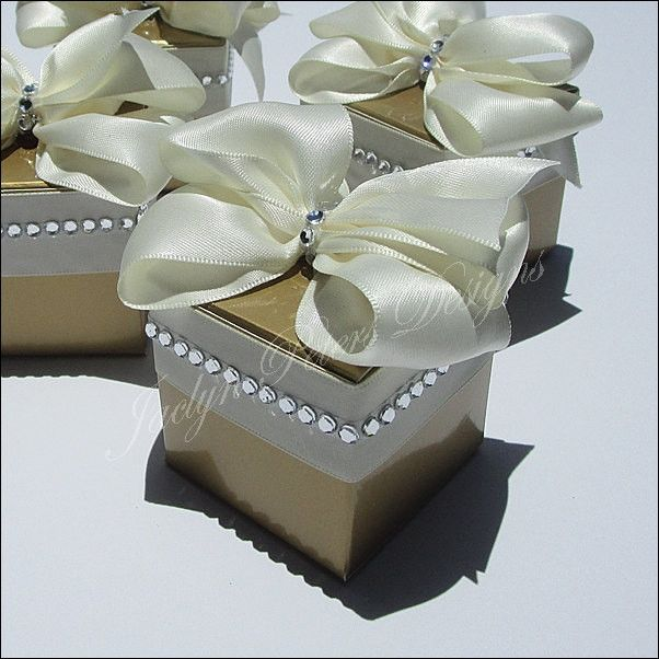 Elegant handmade gold favor boxes with luxury ivory satin bows and silver rhinestones to package package wedding and 50th anniversary thank you gifts. Each arrives fully assembled ready for you to fil