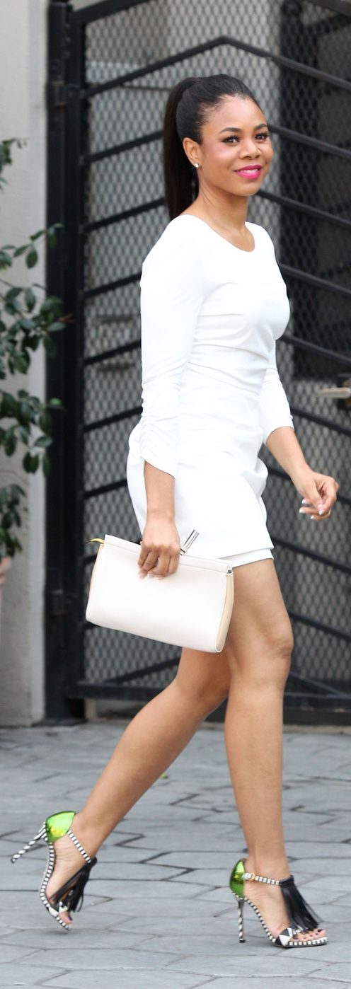 Regina Hall looked phenomenal in a white dress and Sergio Rossi sandals