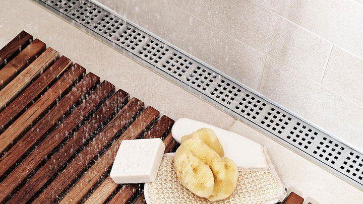 Lattiakaivo asennettuna seinän viereen antaa mahdollisuuden valita kookkaampi lattialaatta.